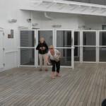 Karen playing deck quoits